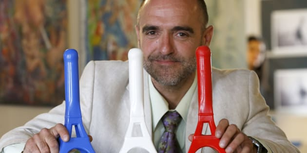 Peruvian-Franco artist Sebastien Lecca poses with his creations 'La Tour est Folle' (Tower is Crazy) sex toys in his workshop at the 59 Rivoli aftersquat in Paris July 12, 2013.