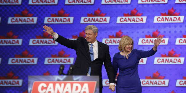 Stephen Harper and his wife Laureen waves to the crowd before he addresses supporters after he lost the federal election to the Liberals in Calgary, Oct. 19, 2015.