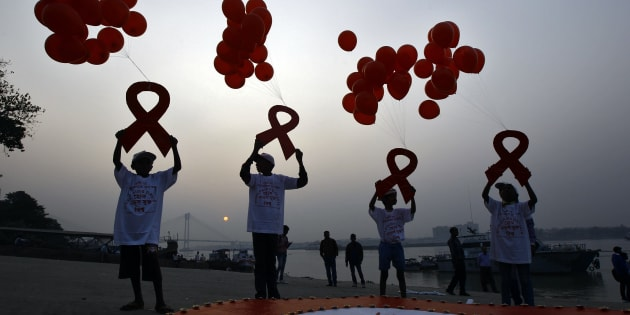 Children display ribbon cut-outs tied to balloons during an HIV/AIDS awareness campaign to mark World AIDS Day in Kolkata.