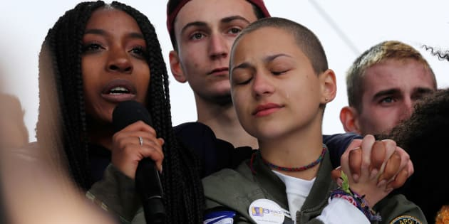 """Shooting survivors Tyra Hemans (L) and Emma Gonzalez (R), from Marjory Stoneman Douglas High School in Parkland, Florida, hug as Hemans addresses the conclusion of the """"March for Our Lives"""" event demanding gun control after recent school shootings at a rally in Washington, U.S., March 24, 2018. REUTERS/Jonathan Ernst"""
