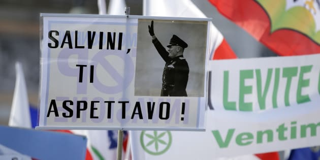 "A placard reading ""Salvini, expecting you,"" with a picture of Italian wartime dictator Benito Mussolini, is held up at a rally held by Northern League party leader Matteo Salvini in Rome, February 28, 2015. REUTERS/Max Rossi (ITALY - Tags: POLITICS CIVIL UNREST)"