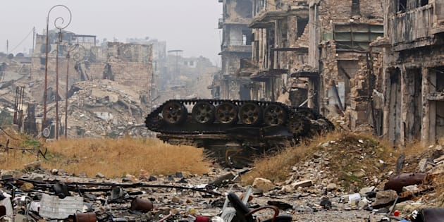 A damaged tank is pictured amid the damage near Umayyad mosque, in the government-controlled area of Aleppo, during a media tour, Syria December 13, 2016. REUTERS/Omar Sanadiki