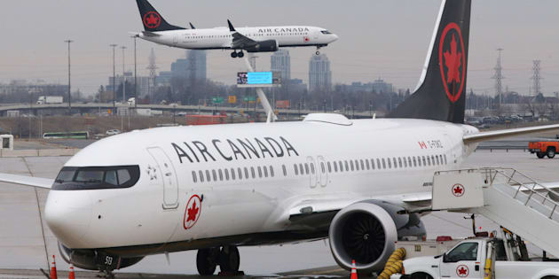An Air Canada Boeing 737 MAX 8 from San Francisco approaches for landing at Toronto Pearson International Airport over a parked Air Canada Boeing 737 MAX 8 aircraft in Toronto on March 13, 2019.