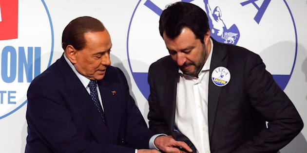 Forza Italia leader Silvio Berlusconi gestures next to Northern League leader Matteo Salvini prior to a meeting in Rome, Italy, March 1, 2018. REUTERS/Alessandro Bianchi
