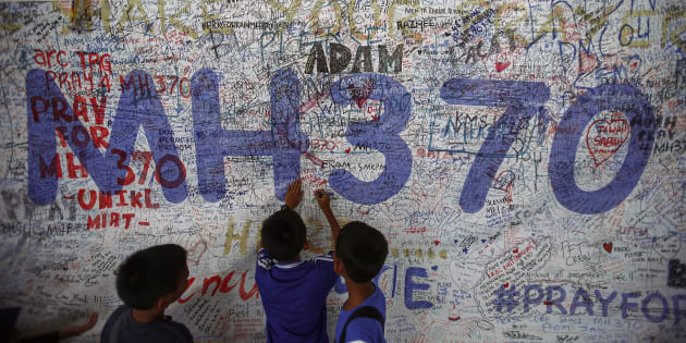 Children write messages of hope for passengers of missing Malaysia Airlines Flight MH370 at Kuala Lumpur International Airport.