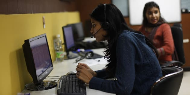 Sheetal, 23, who works at a night call centre, poses for a photograph in her office in New Delhi.
