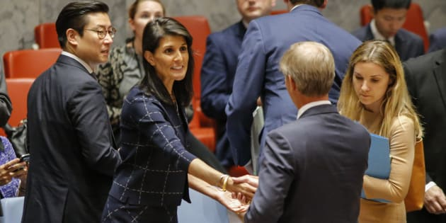 United States Ambassador to the United Nations Nikki Haley speaks with Sweden's ambassador Olof Skoog at a UN Security Council meeting in New York.