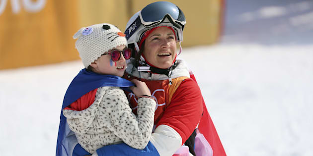 Freestyle Skiing - Pyeongchang 2018 Winter Olympics - Women's Ski Halfpipe Finals - Phoenix Snow Park - Pyeongchang, South Korea - February 20, 2018 - Marie Martinod of France celebrates with daughter. REUTERS/Mike Blake