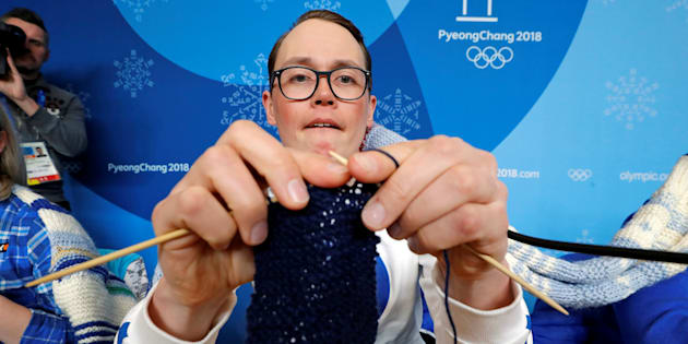 Antti Koskinen, snowboard head coach, shows how he knits, during a news conference in Pyeongchang, South Korea, February 14, 2018.    REUTERS/Eric Gaillard