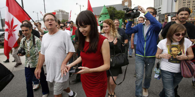 Marijuana advocate Marc Emery (2nd L) and his wife Jodie (3rd L) walk down a street followed by his supporters after he was released from an American prison for selling marijuana seeds in the U.S., in Windsor, Ont. Aug. 12, 2014.