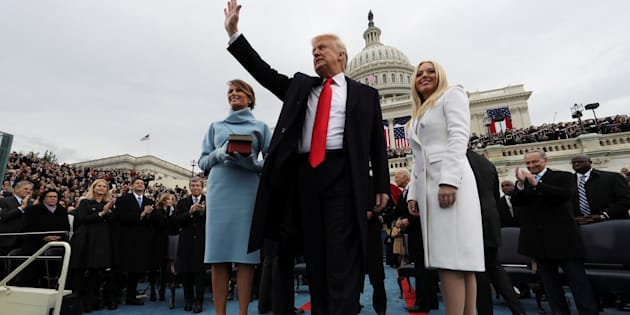 U.S. President Donald Trump acknowledges the audience after taking the oath of office as his wife Melania (L) and daughter Tiffany watch during inauguration ceremonies swearing in Trump as the 45th president of the United States on the West front of the U.S. Capitol in Washington, DC, U.S., January 20, 2017.  REUTERS/Jim Bourg   TPX IMAGES OF THE DAY