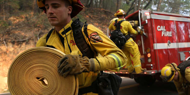 Firefighters work to contain a wildfire outside Calistoga, California, U.S.