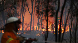 NSW Bushfire Threat Downgraded As Authorities Assess Property