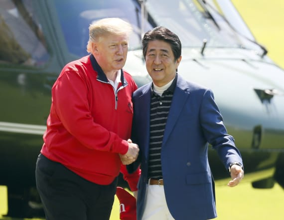 Trump defends Kim, downplays NK missile threat