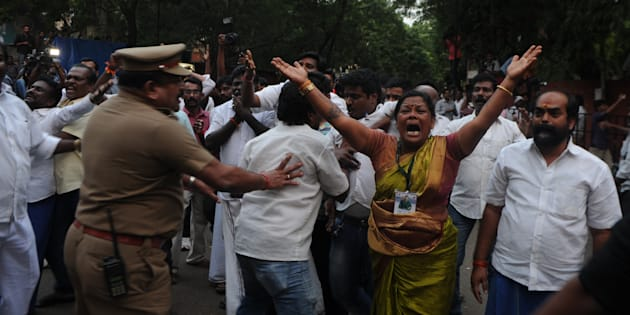 Supporters of the Chief Minister of Tamil Nadu J Jayalalithaa react outside the hospital where she is being treated after false reports that she had died.