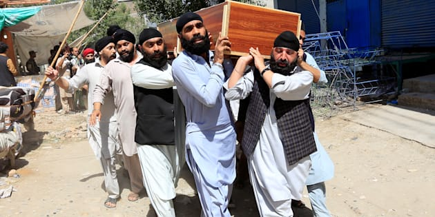 Afghan Sikh men carry the coffin of one of the victims of yesterday's blast in Jalalabad city, Afghanistan July 2, 2018. REUTERS/Parwiz
