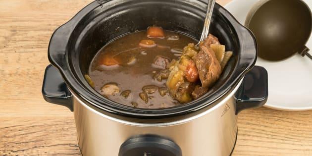 A slow cook crock pot beef dinner on a kitchen worktop