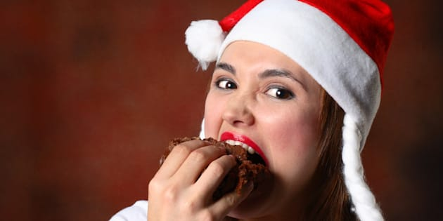 Santa girl eating cake