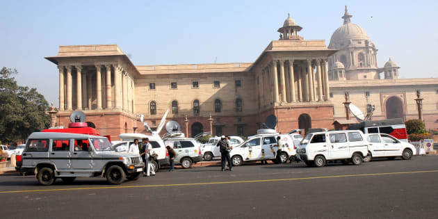 Media OB Vans (Vehicles) outside the North Block, in Delhi, India.