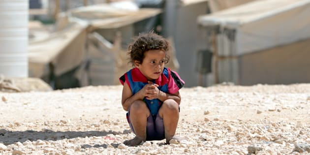 This is no normal life: a young syrian child plays in the dirt at  Za'atari refugee camp.