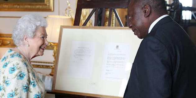 Britain's Queen Elizabeth II presents 1990s correspondence between herself and Nelson Mandela regarding South Africa's return to the Commonwealth as a gift to President Cyril Ramaphosa during an audience at Windsor Castle, Berkshire on April 17, 2018, on the sidelines of the Commonwealth Heads of Government meeting.