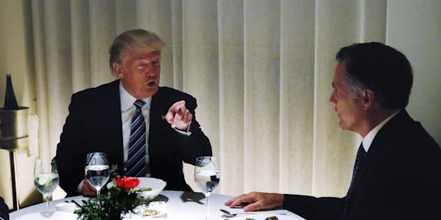 U.S. President-elect Donald Trump sits at a table for dinner with former Massachusetts Governor Mitt Romney (R) at Jean-Georges inside of the Trump International Hotel & Tower in New York, U.S., November 29, 2016.  REUTERS/Lucas Jackson