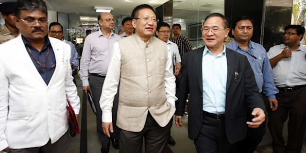 NEW DELHI, INDIA - MARCH 27: Arunachal Pradesh Chief Minister Nabam Tuki (R) shares a light moment with his Nagaland counterpart TR Zeliang after the first meeting of the sub-group of Chief Ministers at NITI Aayog on March 27, 2015 in New Delhi, India. NITI Aayog will set up a working group to prepare a draft report on how to make implementation of Centrally Sponsored Schemes (CSS) more effective. (Photo by Arun Sharma/Hindustan Times via Getty Images)