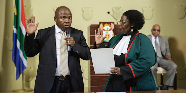 David Douglas Des van Rooyen (L) raises his hand as he is sworn-in by Justice minister Sisi Khampepe as the new South African Finance Minister on December 10, 2015 at Union Builidngs in Pretoria, South Africa.