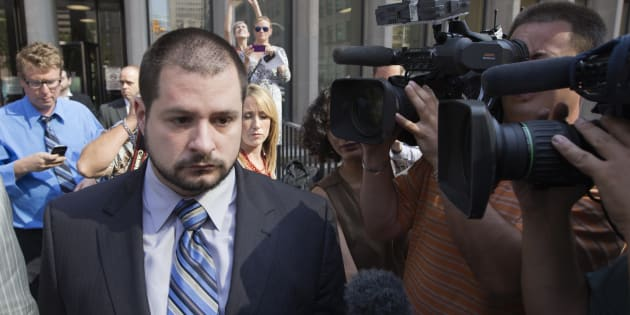 Toronto police officer Constable James Forcillo (L) leaves the court after being let out on bail in Toronto, August 20, 2013.
