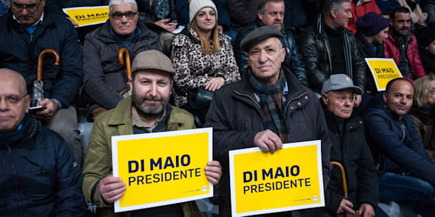 POMIGLIANO D'ARCO, ITALY - FEBRUARY 12: Supporters of the Five Star Movement hold up signs reading 'Di Maio President' at a rally attended by Luigi Di Maio, premier candidate for the Five Star Movement (Movimento Cinque stelle) at the next Italian Political Elections, during an event organized in the Palazzetto dello Sport of his hometown, in the presence of local candidates and the regional councilor Valeria Ciarambino, on February 12, 2018 in Pomigliano D'Arco, Italy. The Italian General Election takes place on March 4th 2018. (Photo by Ivan Romano/Getty Images)