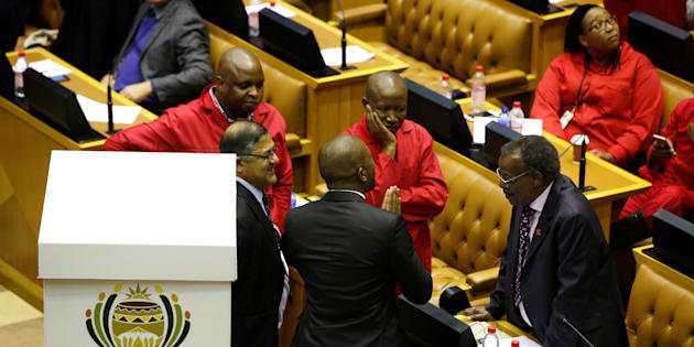 Opposition party leaders confer shortly before voting during the motion of no confidence in President Jacob Zuma last year.