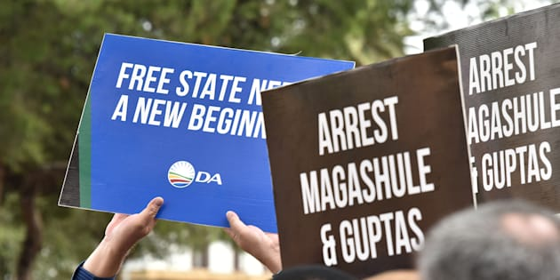 DA and EFF members demonstrate in front of the Bloemfontein Regional Court as the suspects linked to the Estina dairy farm fraud and corruption investigation appeared in court on February 15, 2018.
