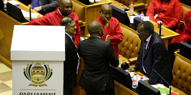 Opposition party leaders Mmusi Maimane (DA), Julius Malema (EFF) and Mangosuthu Buthelezi (IFP)  confer shortly before voting during the motion of no confidence against President Jacob Zuma in Parliament.