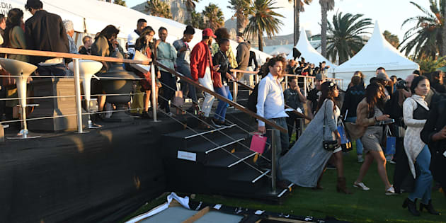 Guests leave the Mercedes-Benz Fashion Week Cape Town in Camps Bay, due to strong winds. This was an opportunity for local fashion designers to showcase their talent.