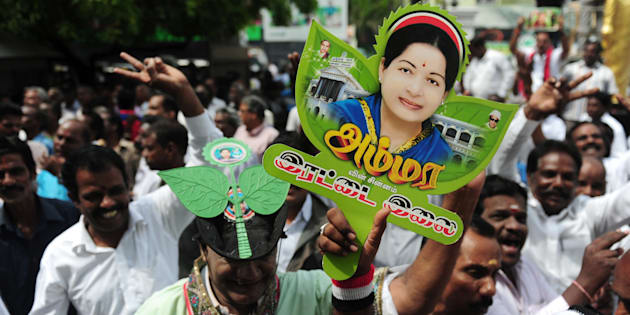 Members of AIADMK party carry placards with  the image of Jayalalithaa. ARUN SANKAR/AFP/Getty Images