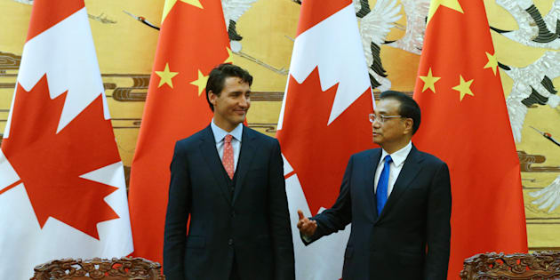Chinese Premier Li Keqiang and Prime Minister Justin Trudeau talk at the Great Hall of the People in Beijing on Aug. 31, 2016.