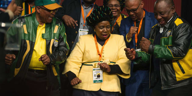 South African President Jacob Zuma (L), former African Union Chairperson and presidential hopeful Nkosazana Dlamini-Zuma (C) and South African Deputy President Cyril Ramaphosa (R) dance after the closing session of the South African ruling party African National Congress (ANC) policy conference on July 5, 2017 in Johannesburg, South Africa.