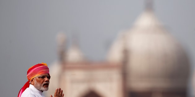 Indian Prime Minister Narendra Modi gestures as he addresses the nation from the historic Red Fort during Independence Day celebrations in Delhi.