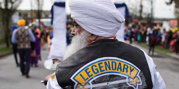 Sikh motorcycle club member Dalel Singh Brar sports the Humboldt Broncos hockey team logo on his vest to honour the victims of the Saskatchewan bus crash, while riding in the Vaisakhi parade in Vancouver on April 14, 2018.