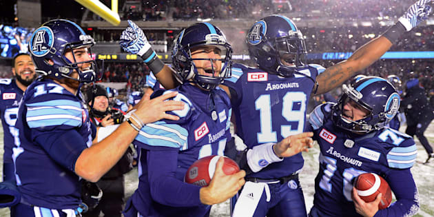 Toronto Argonauts quarterback Ricky Ray celebrates with teammates after defeating the Calgary Stampeders at the 105th Grey Cup on Nov. 26, 2017 in Ottawa.