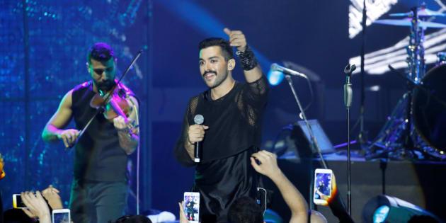 Hamed Sinno (R), the lead singer of Lebanese alternative rock band Mashrou' Leila performs during the Ehdeniyat International Festival in Ehden town, Lebanon Aug. 12, 2017.