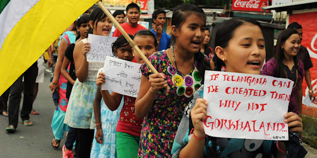 Indian school children hold placards and party flags as they take part in a rally for the support of Gorkhanland during a day long relaxation of an indefinite strike at Sukna village on the outskirts of Siliguri on August 31, 2013.