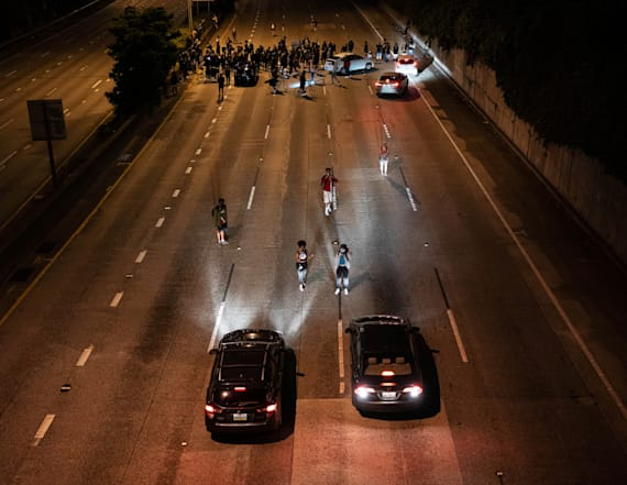 2 hit by car on highway closed amid protests