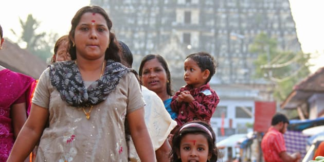 Indian women with children walking at the famous temple Sri Padmanabhaswamy.