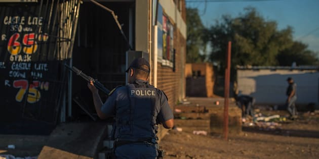 South African riot police fire rubber bullets to prevent looting in North West Province on April 20, 2018, as protests continued for a second day in Mahikeng.