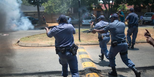 Armed police clash with protesters, including disgruntled parents, ANC supporters and EFF supporters, at Hoërskool Overvaal on January 17, 2017.