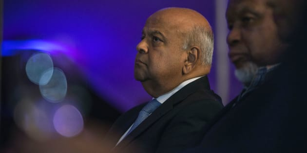 Former finance minister Pravin Gordhan (L) and former president Kgalema Mothlante (R) attend the opening night of the documentary film Promises and Lies screening at the Constitutional Hill on May 4, 2017 in Johannesburg.