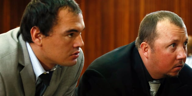 Willem Oosthuizen (L) and Theo Martins Jackson (R) look on during proceedings at The Middelburg Magistrate Court in Mpumalanga on August 25, 2017.