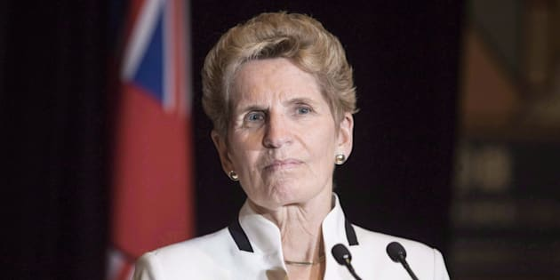 Ontario Premier Kathleen Wynne talks to media at the Confederation of Tomorrow 2.0 Conference in Toronto on Dec. 12, 2017.