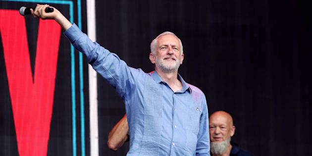 Labour leader Jeremy Corbyn speaks to the crowd from the Pyramid stage at Glastonbury Festival, at Worthy Farm in Somerset.
